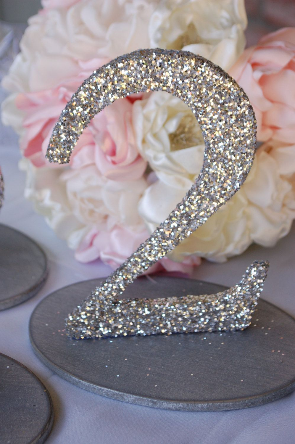 Glitter Wedding Table Numbers In Gold Please And Love The Flowers Behind It