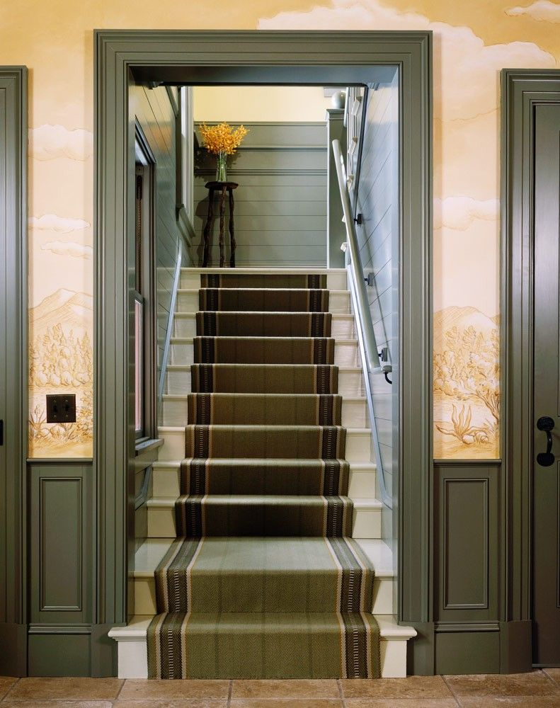 home interior design stairs%0A The back staircase is a study in country refinement  Off white stairs are  lined with long avocado green staircase runner that compliments the green  paneled