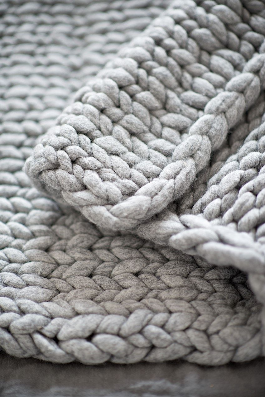 DIY Knit a chunky blanket from wool roving. Perfect for