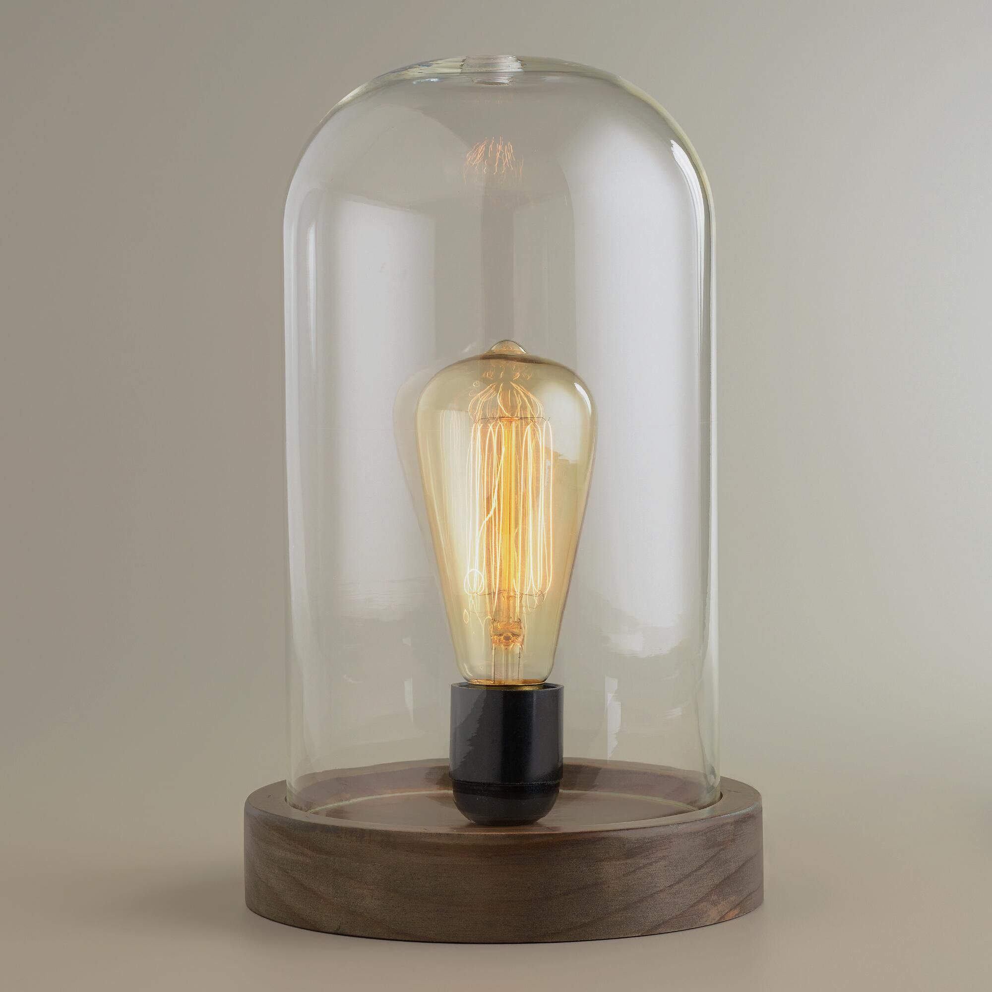 Crafted of glass with a wooden base our exclusive Edison Glass