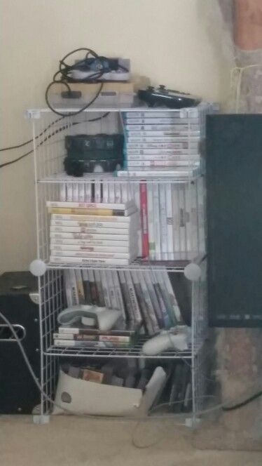 Multigenerational Video Game Storage from metal cube storage. Zip ties created middle shelves in each cube.