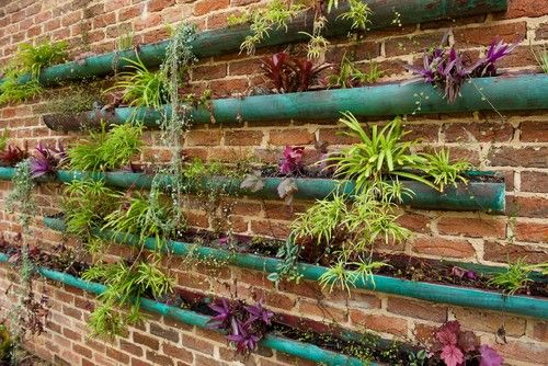 Vertical Garden Starting At The Brick Wall Stack Gutter Like Copper Vessels Along Its Face Co Vertical Garden Design Sustainable Garden Design Gutter Garden