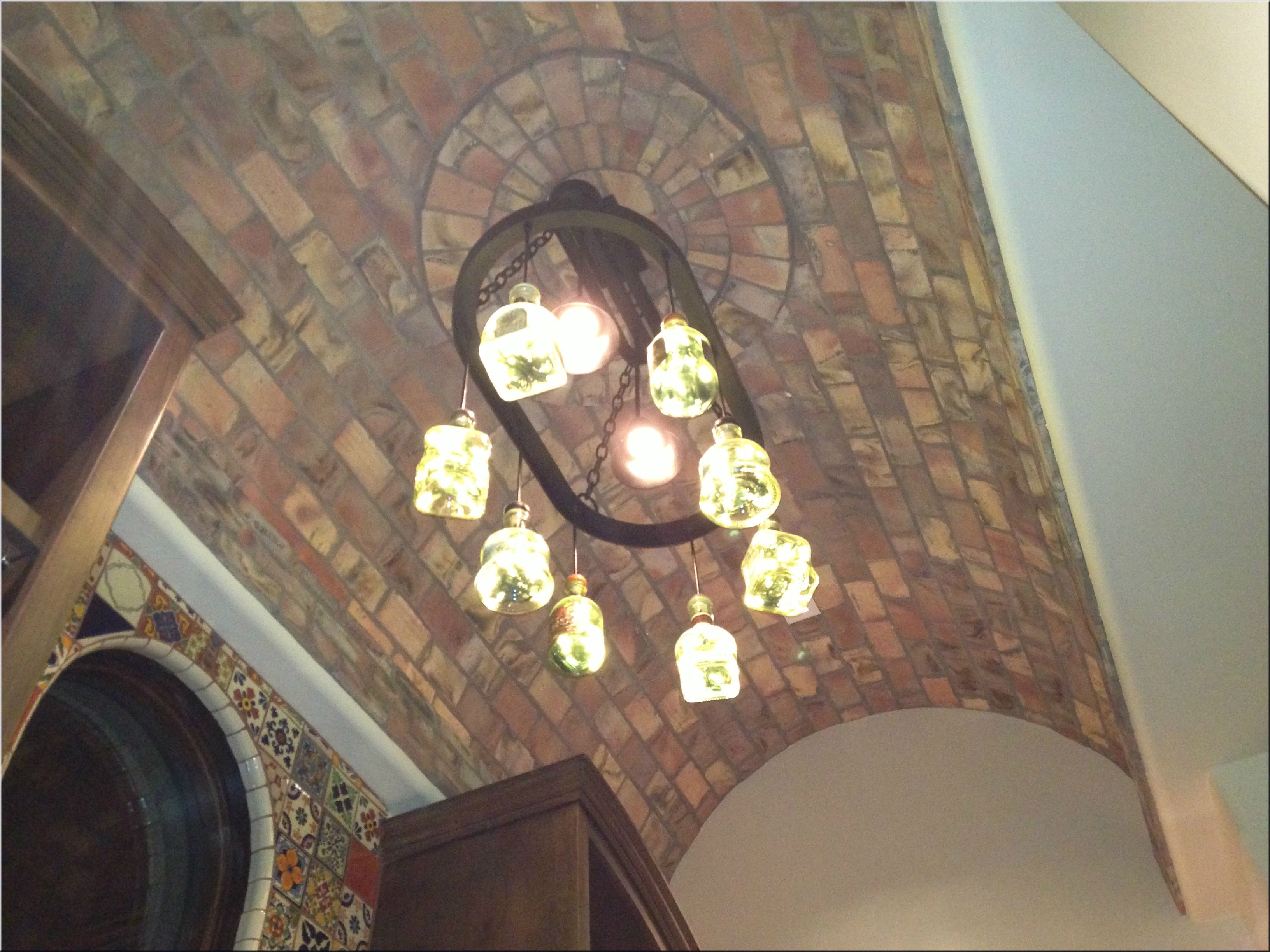 Spanish colonial dining room brick ceiling bottle chandelier spanish colonial dining room brick ceiling bottle chandelier talavera tile on walls dailygadgetfo Gallery