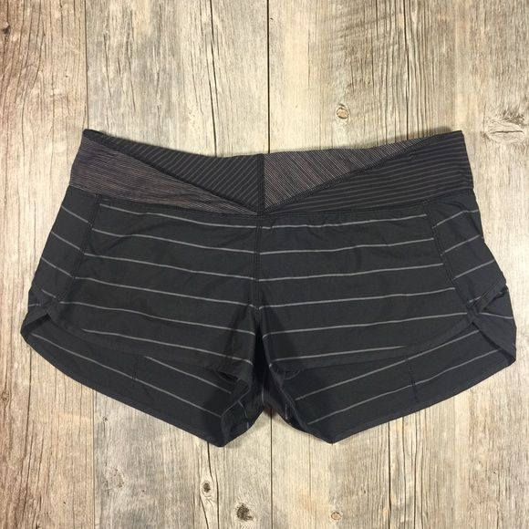 Lululemon black and gray stripe speed shorts Lululemon black and gray stripe speed shorts. 2 waistband pockets, zipper pocket in back. Pull continuous cord waist. 11 inches long. 2 1/2 inch inseam. Approx 33 inch waist. No tag. Great condition, no signs of wear. 43 inch hips, according to their website its closest to size 12/XL. lululemon athletica Shorts