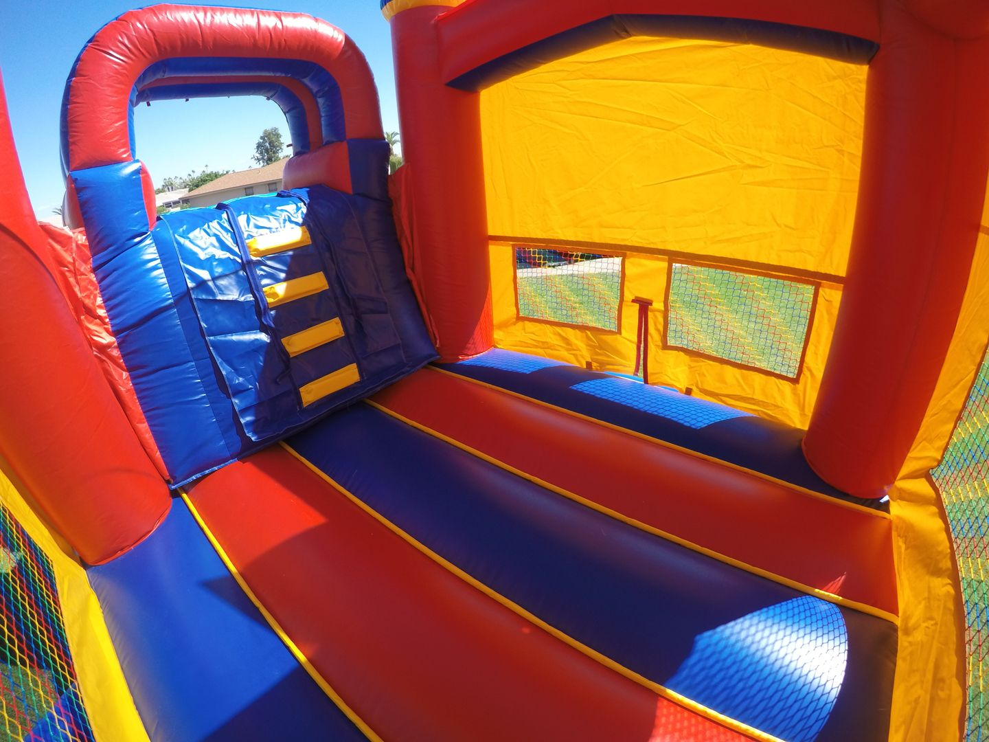 awesome red yellow blue combo bounce house slide with bumper can be