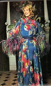 She looks like a perfectly groomed peacock in her silky dress. #1970s #vintage #clothing #fashion