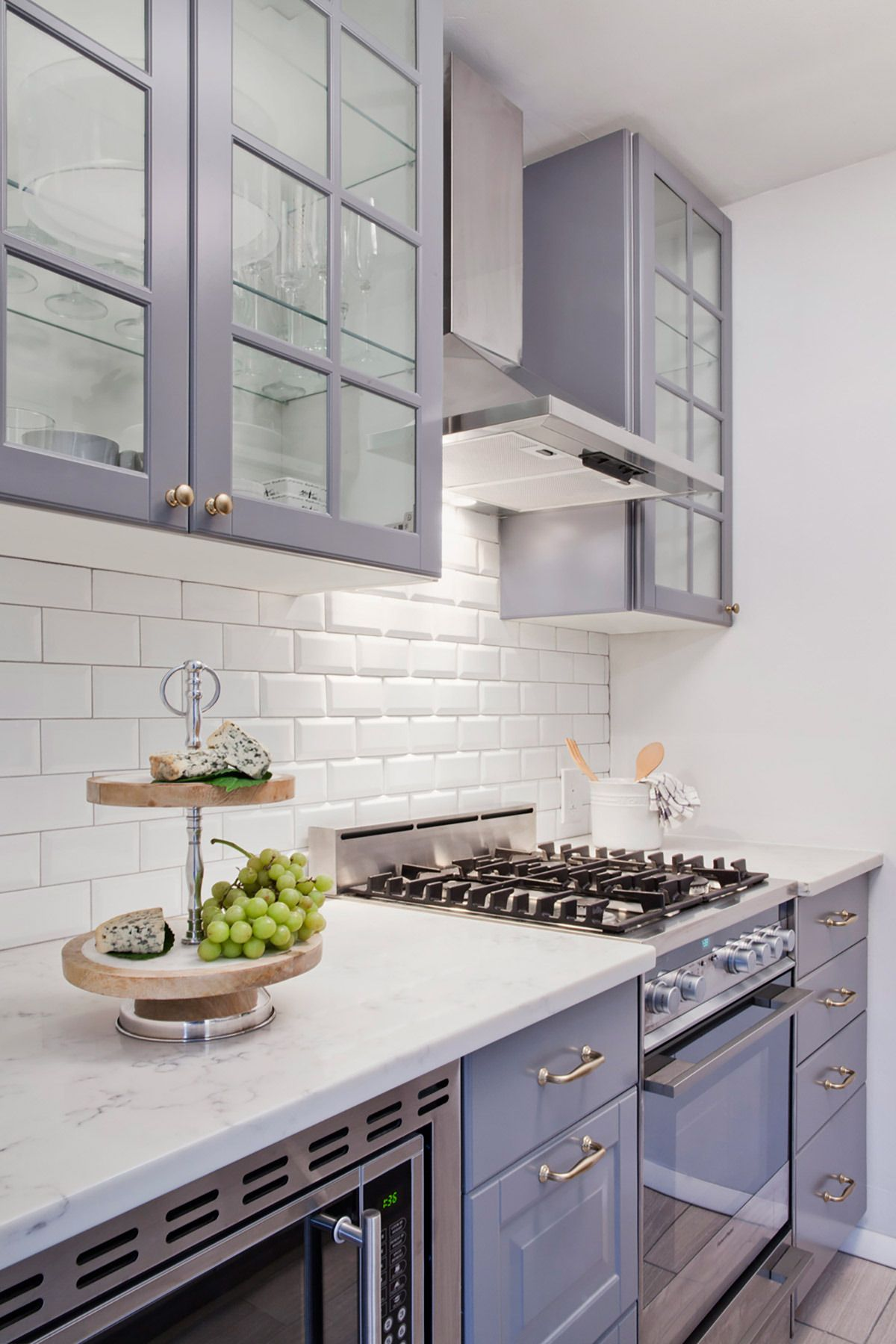 Grey IKEA cabinetry paired with white subway makes for a perfect small kitchen space Love