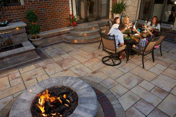 fire pit and patio with unilock rivenstone paver rivenstone