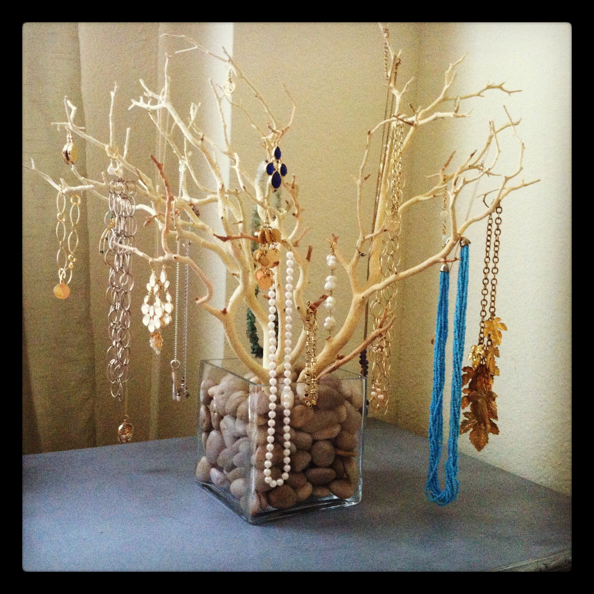 I found sand blasted manzanita branches online, tapped them together ...