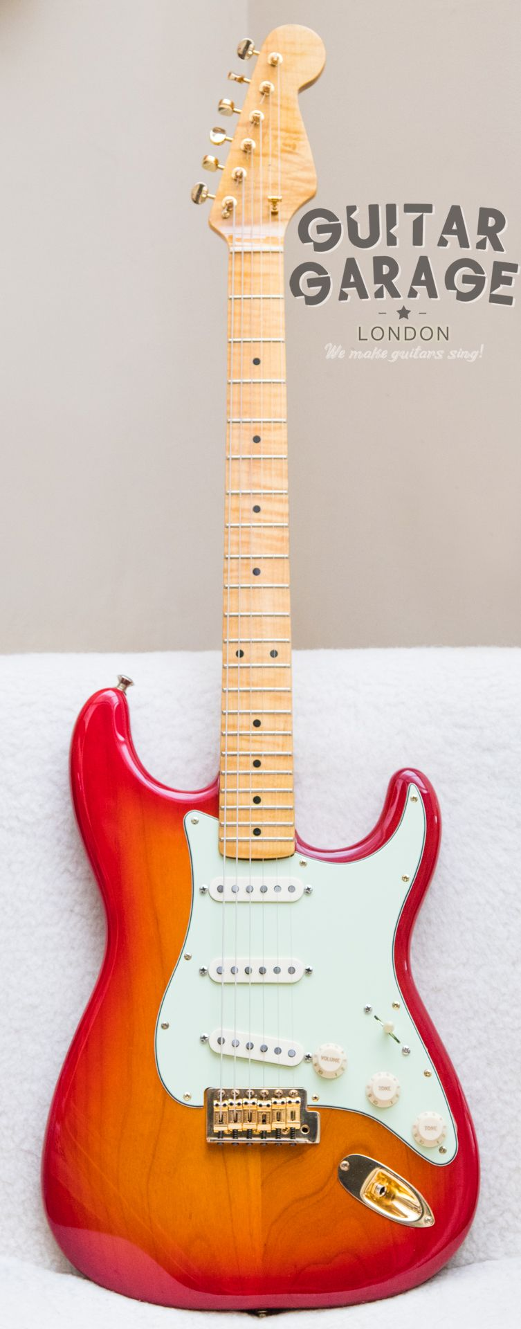 2014 Fender Stratocaster Custom Swamp Ash with AAA+ Flame neck and AmSt pickups and gold hardware