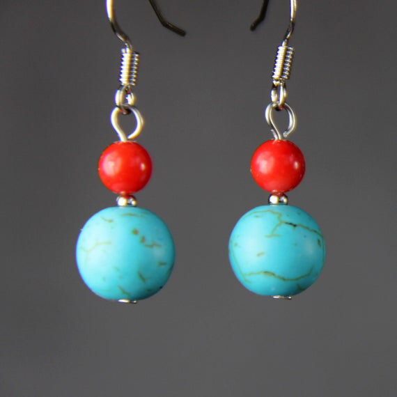Turquoise coral drop earrings, bridesmaid gift, gift for her, wedding gift, birthday gift, anniversary gift, gift for mom, free US shipping #turquoisecoralweddings These teardrop earrings are handmade using Turquoise. Perfect gift for any occasion! Free U.S shipping! Anni Designs. Turquoise, the birthstone of December, some Native cultures held the belief that by wearing it the human mind becomes one with the universe. Turquoise and coral drum up a livelier #turquoisecoralweddings