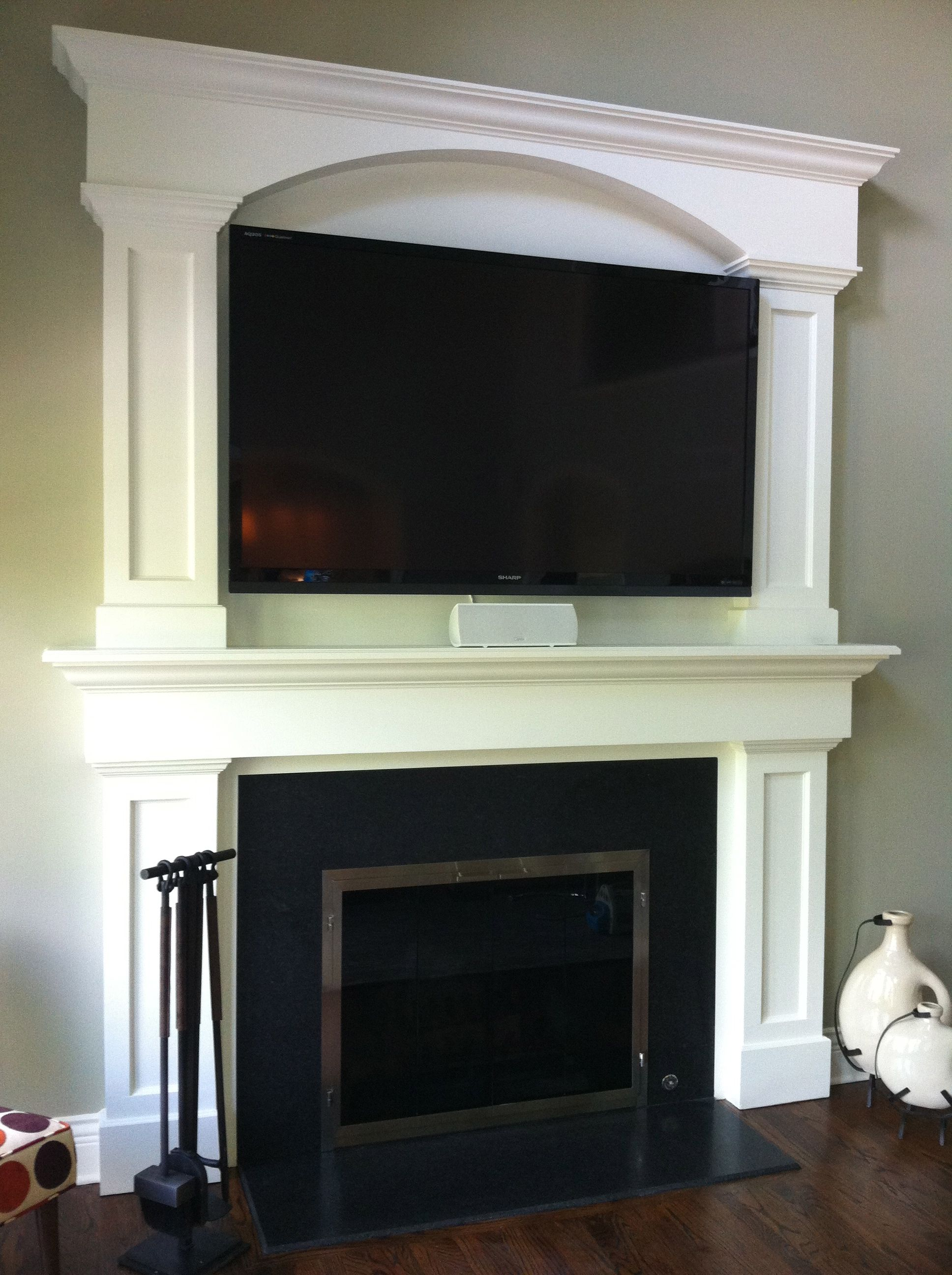 custom fireplace surround tv above fireplace granite face around