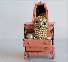 love the pearled owl perched on the open drawer.