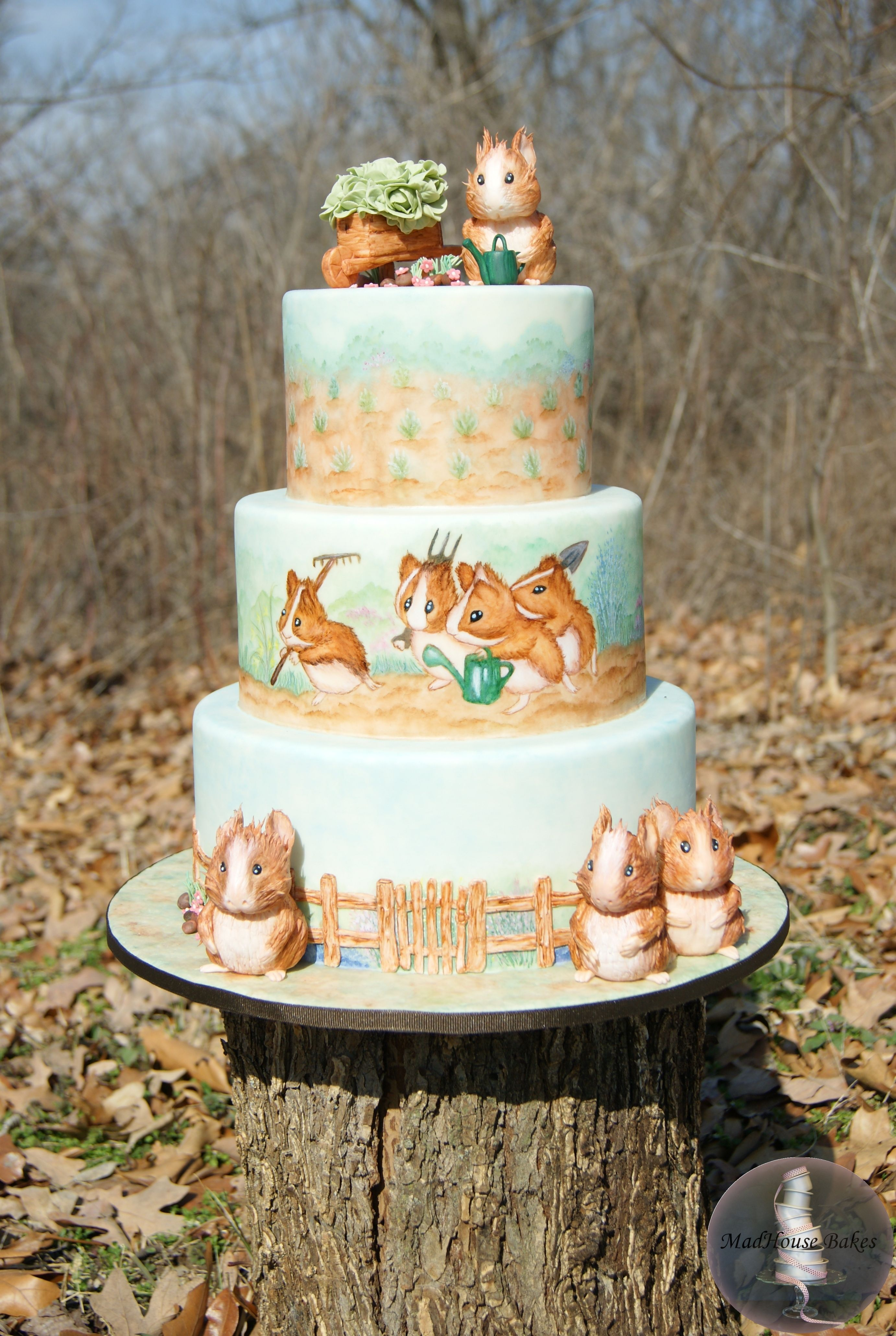 Beatrix Potter Guinea Pig Cake - Cecily Parsley's Nursery Rhymes by Beatrix Potter to use as inspiration. Each tier is hand painted using food colors. All of the guinea pigs are sculpted from gumpaste.