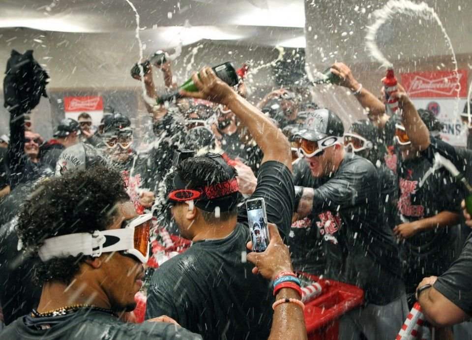 Cleveland Indians Team Celebrate With Champagne In The Locker Room After They Beat Detroit Tigers