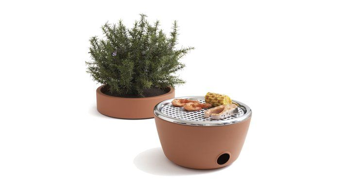 wow. this is too perfect for anyone with only a small balcony or patio. a grill disguised as an herb garden.