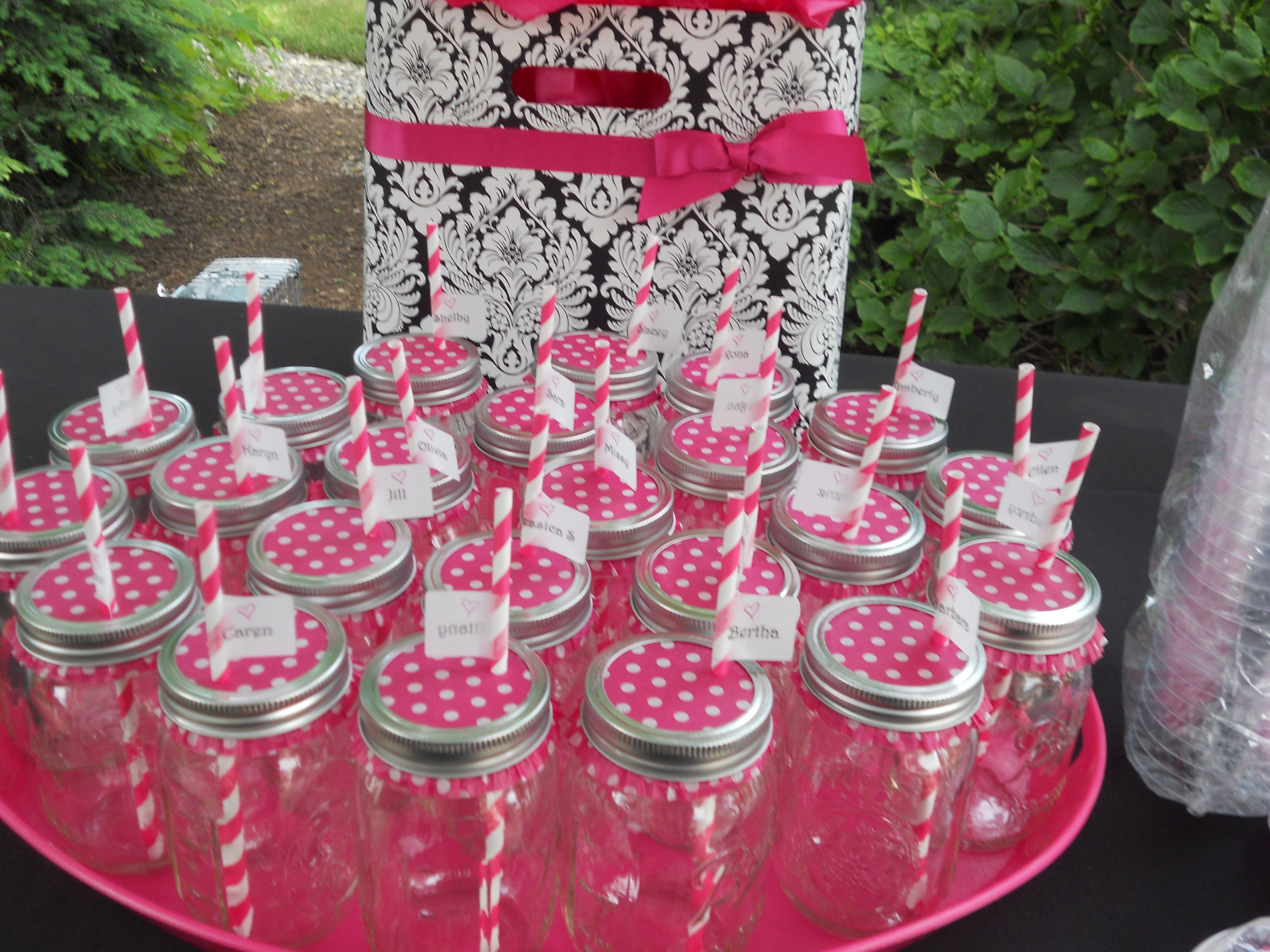 Mason jars covered with cupcake liners and straws with name labels ...