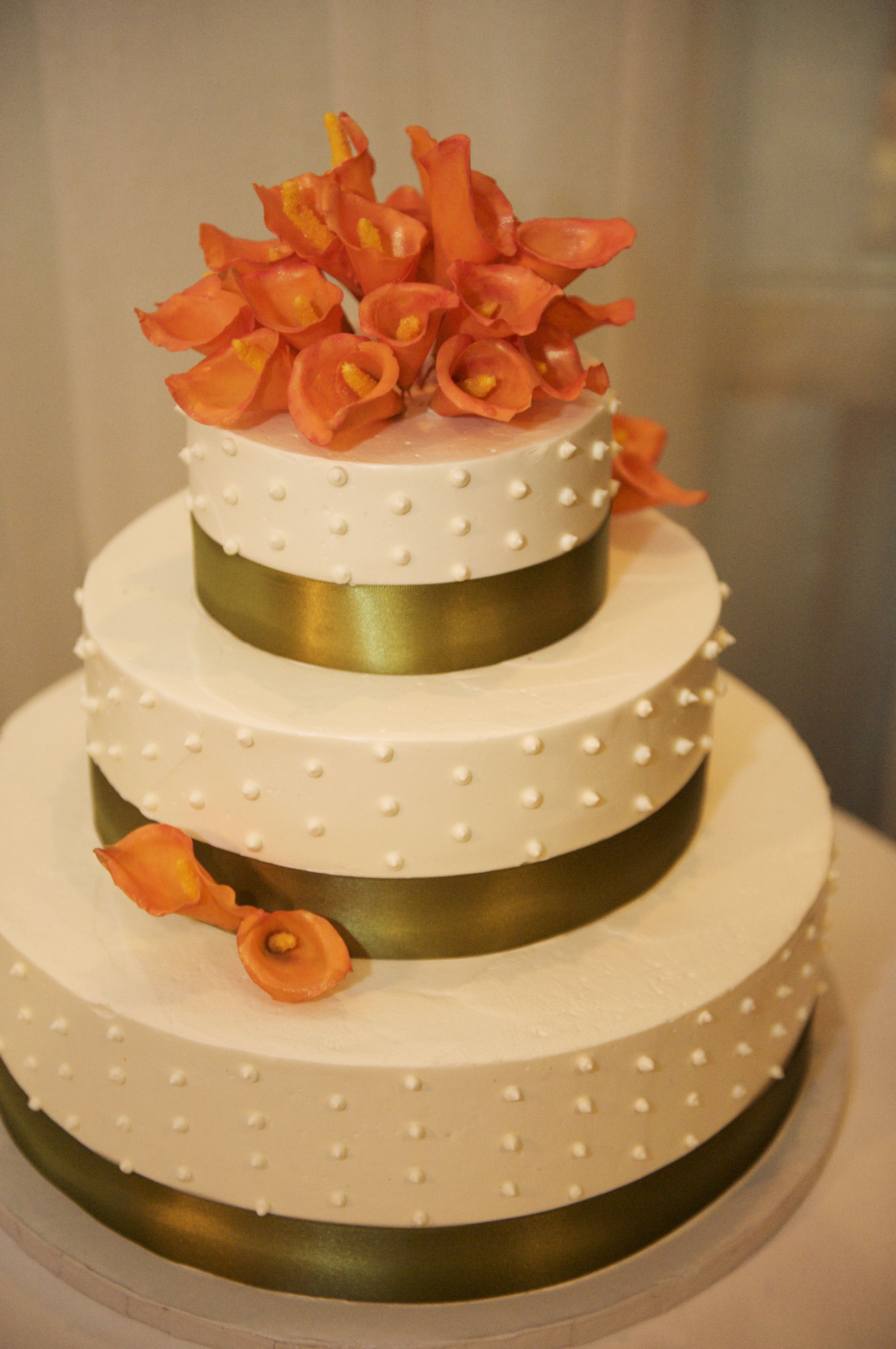 Love this cake, but with wild orange lilies and brown ribbon ...