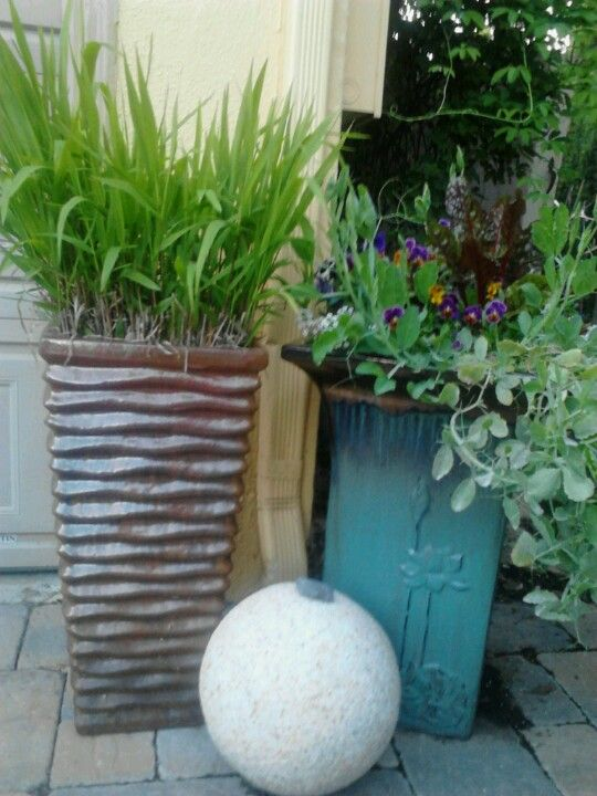 Even the driveway can be made pretty with nice pots & granite.