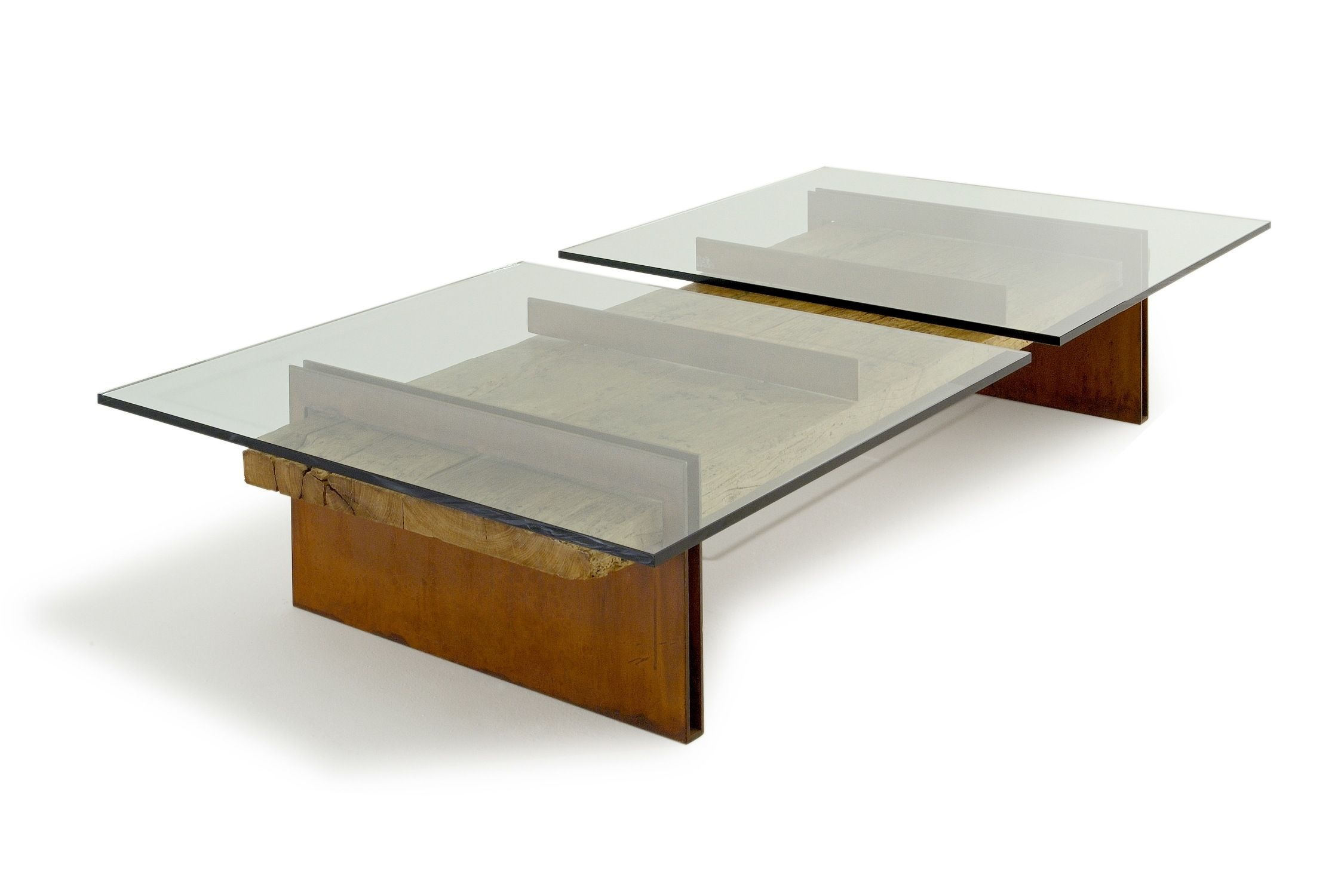 Yan dining table with a unique triangular designed base and glass