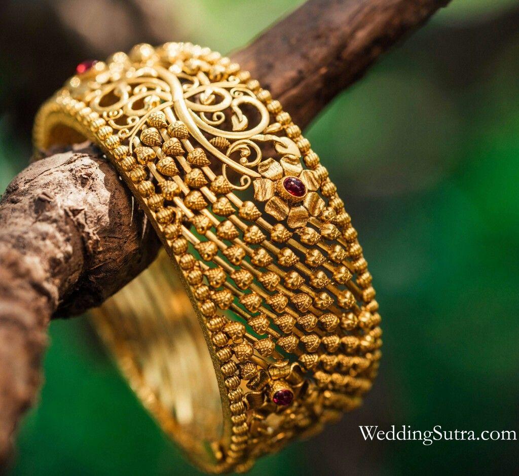 624c519c832f9 Azva gold flower bangle on WeddingSutra bride #Goldjewellery #luxury ...