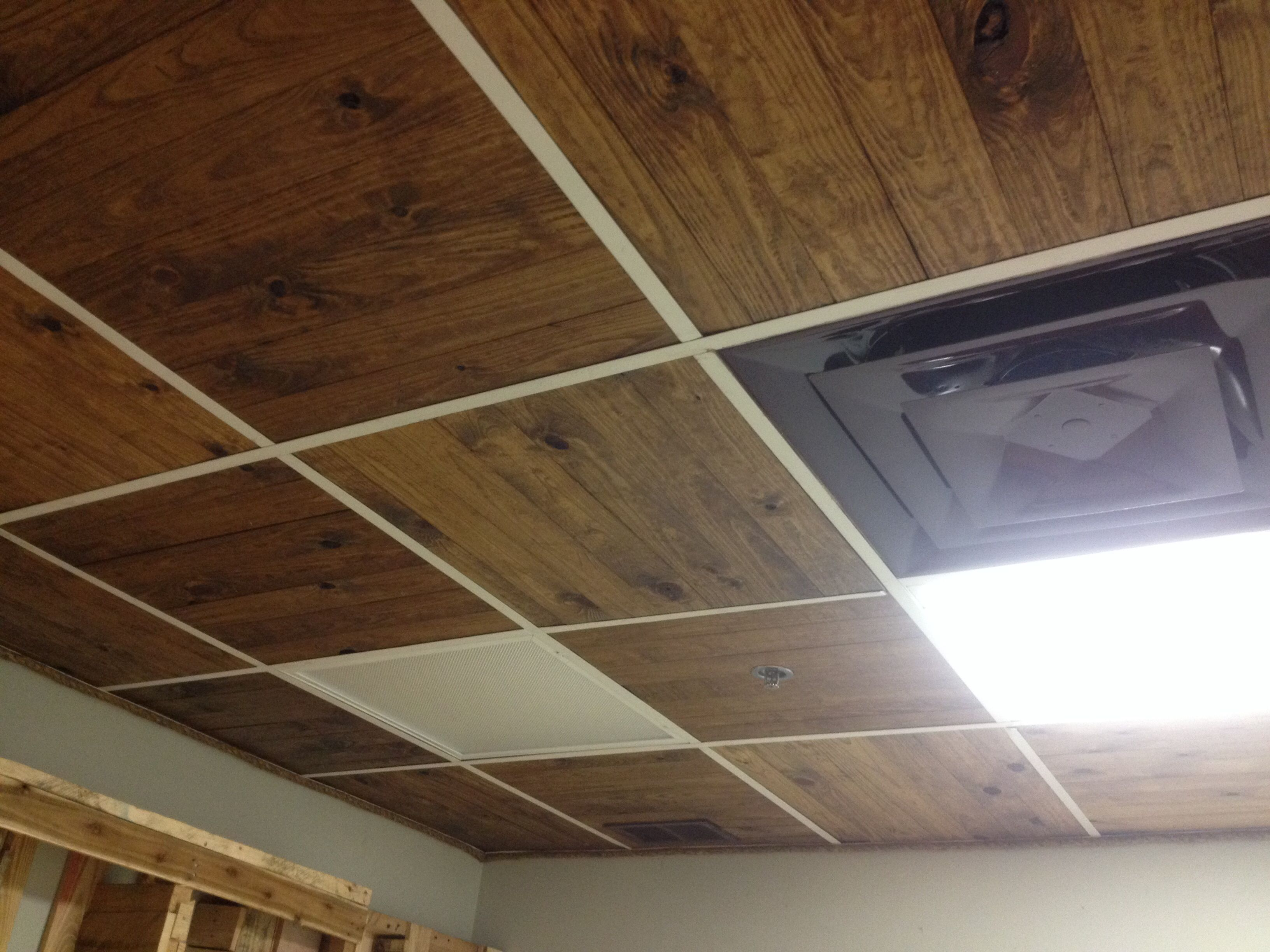 Wooden slats replace ceiling tile but paint hangers black and run wooden slats replace ceiling tile but paint hangers black and run grain same way dailygadgetfo Image collections