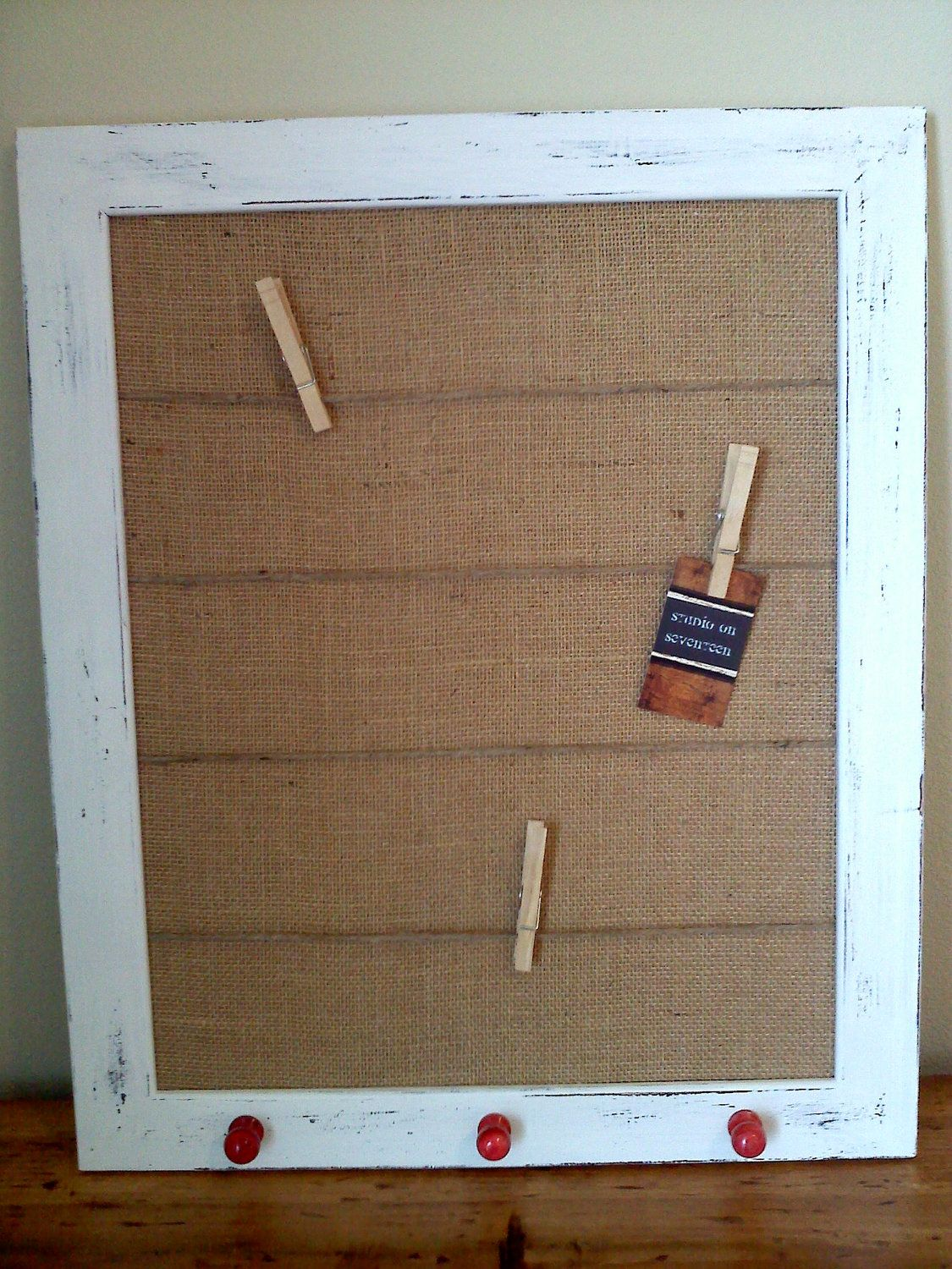 Distressed White Frame - Tan Burlap Covered Cork Board - Red knobs ...