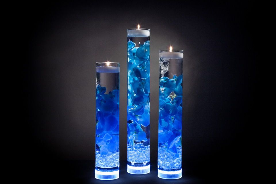 Beautiful Blue Floral Centerpieces With Led Lights And Candles Blue Wedding Decorations Blue Centerpieces Royal Blue Wedding Decorations