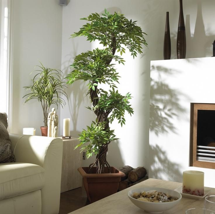 Genial Home Decor, Fresh Room With White Concept Pretty And Natural Fake Trees  Beside A Fireplace