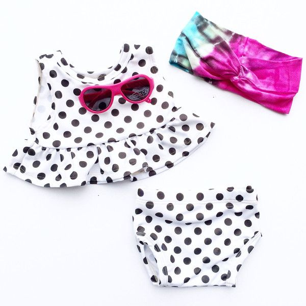 This adorable swim suit is a must-have for any beach vacation or pool trip!  Exclusively available at rOw10 -- polka dot swimmie has major Shirley Temple vibes! Babiators and tie dye headbands for babies are cute accessories for summer!