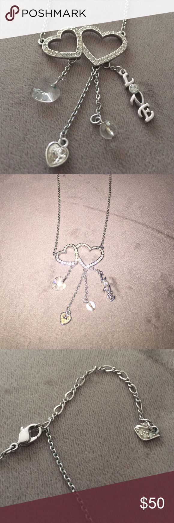 Swarovski Necklace Swarovski necklace. Two open hearts with four floatinf charms. No stones are missing. Excellent condition. Adjustable clasp. 100% authentic. Swarovski Jewelry Necklaces