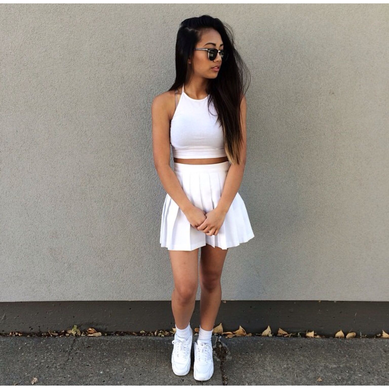 More casual outfit of a two piece, white dress paired with white high top  Vans(making the outfit more of a casual one)