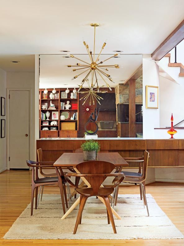 Reflecting The Vintage Sputnik Chandelier An Original Mirrored Wall Over Walnut Buffet Expands Dining Room