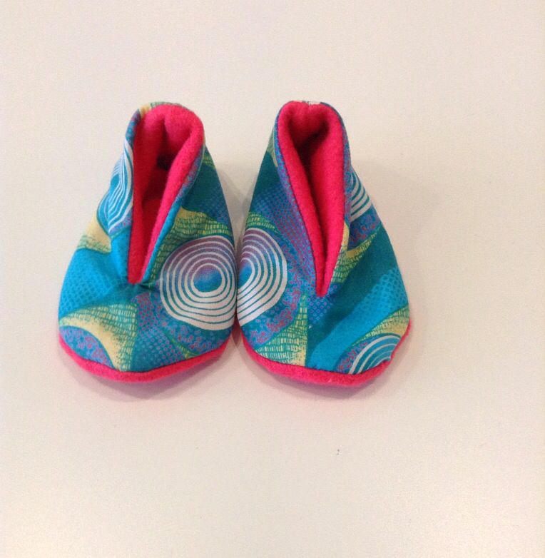Hand made baby shoes. African fabrics