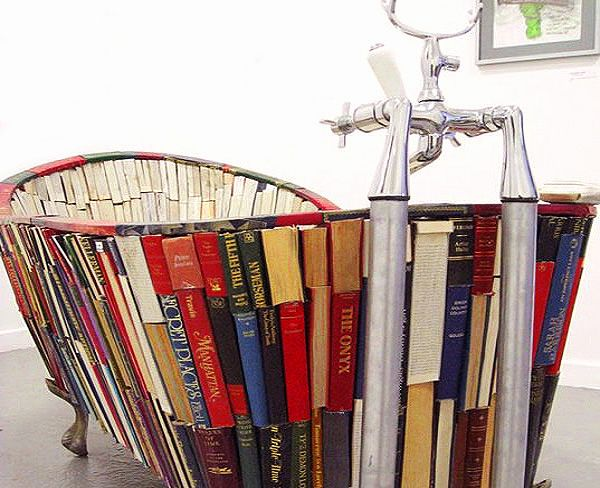 Home furnishing ideas for book lovers, including this incredible bathtub!