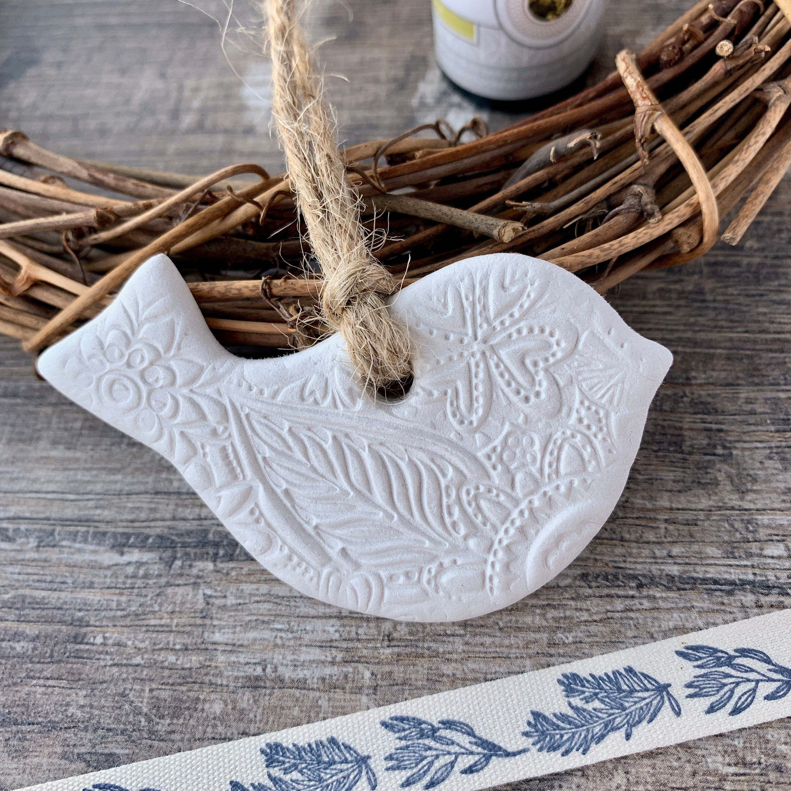 Photo of Bird Decoration – White Clay, Floral Pattern