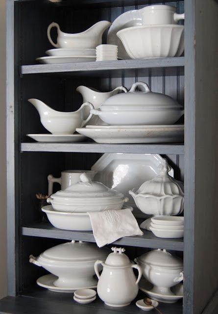 grey shelves white china