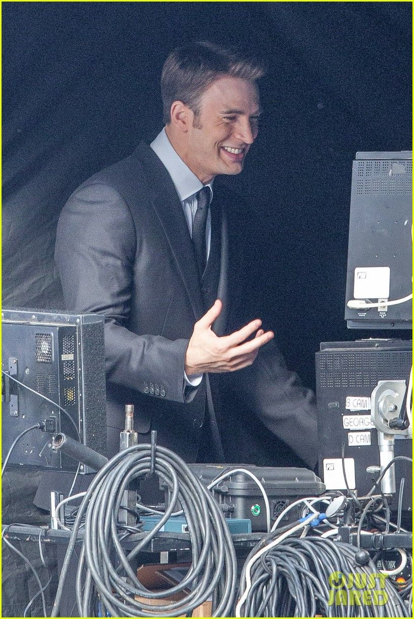 *EXCLUSIVE* **SHOT ON 5/1315** Atlanta, GA - Chris Evans has a laugh with a crew member while checking out his last scene on the small screen before shooting another take, today he looked dapper wearing a dark suit with matching dress shoes. AKM-GSI May 14, 2015 To License These Photos, Please Contact : Steve Ginsburg (310) 505-8447 (323) 423-9397 steve@akmgsi.com sales@akmgsi.com or Maria Buda (917) 242-1505 mbuda@akmgsi.com ginsburgspalyinc@gmail.com