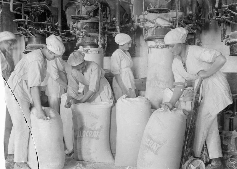 Female workers pack flour in a mill at the works of Rank and Sons, Birkenhead, September 1918. Fines were issued for making white flour instead of wholewheat and for allowing rats to invade wheat stores. Further restrictions on food production eventually led to the introduction of rationing in 1918.
