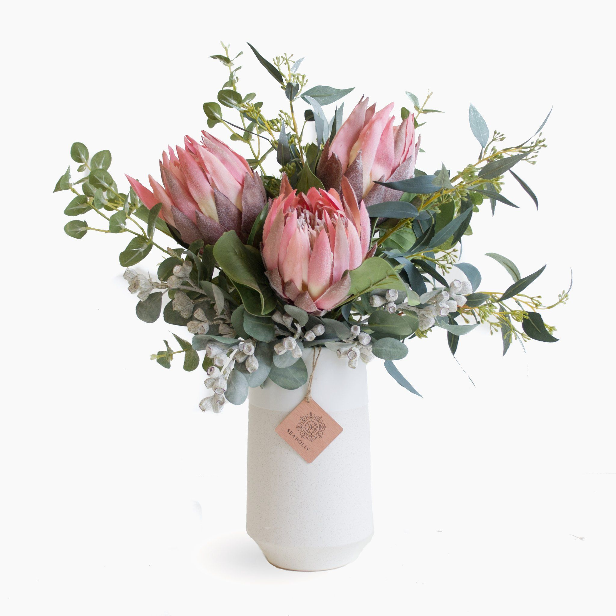 Pink Protea Eucalyptus And Tetra Nuts In Vanilla Vase Flower Vase Arrangements Australian Flowers Flower Arrangements