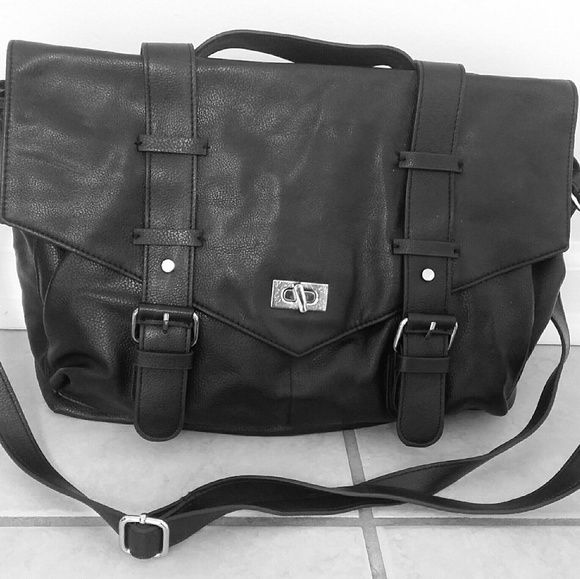 Black H&M Messenger Bag Super cute black messenger bag from H&M with silver buckle details and silver fold over lock flap closure. Has a body/shoulder strap and a top handle so you can tuck in the long strap into the bag and just carry by handle if you prefer. Only used a few times and in perfect condition! H&M Bags Shoulder Bags