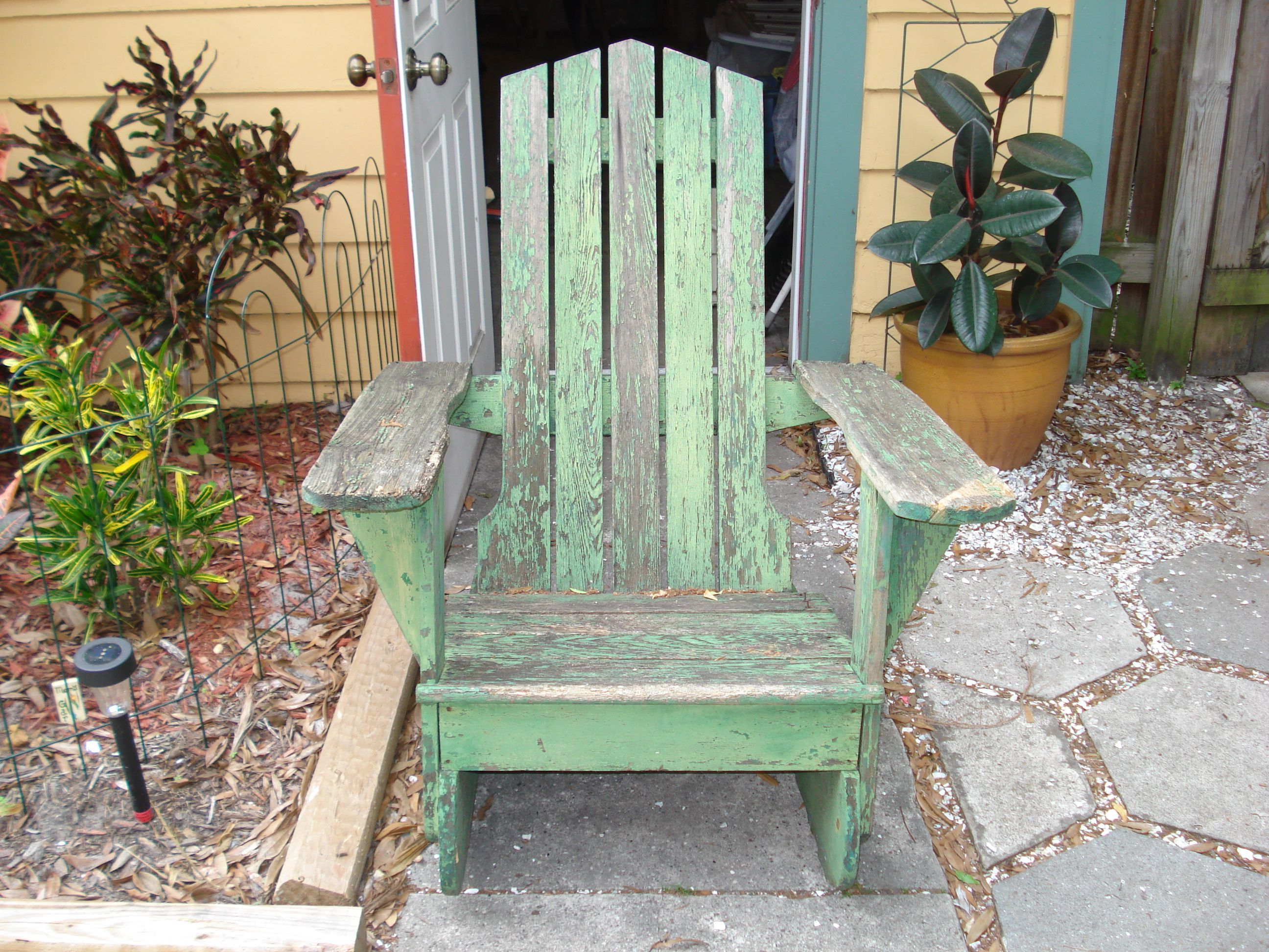 Neighbors were throwing out this old rocking chair