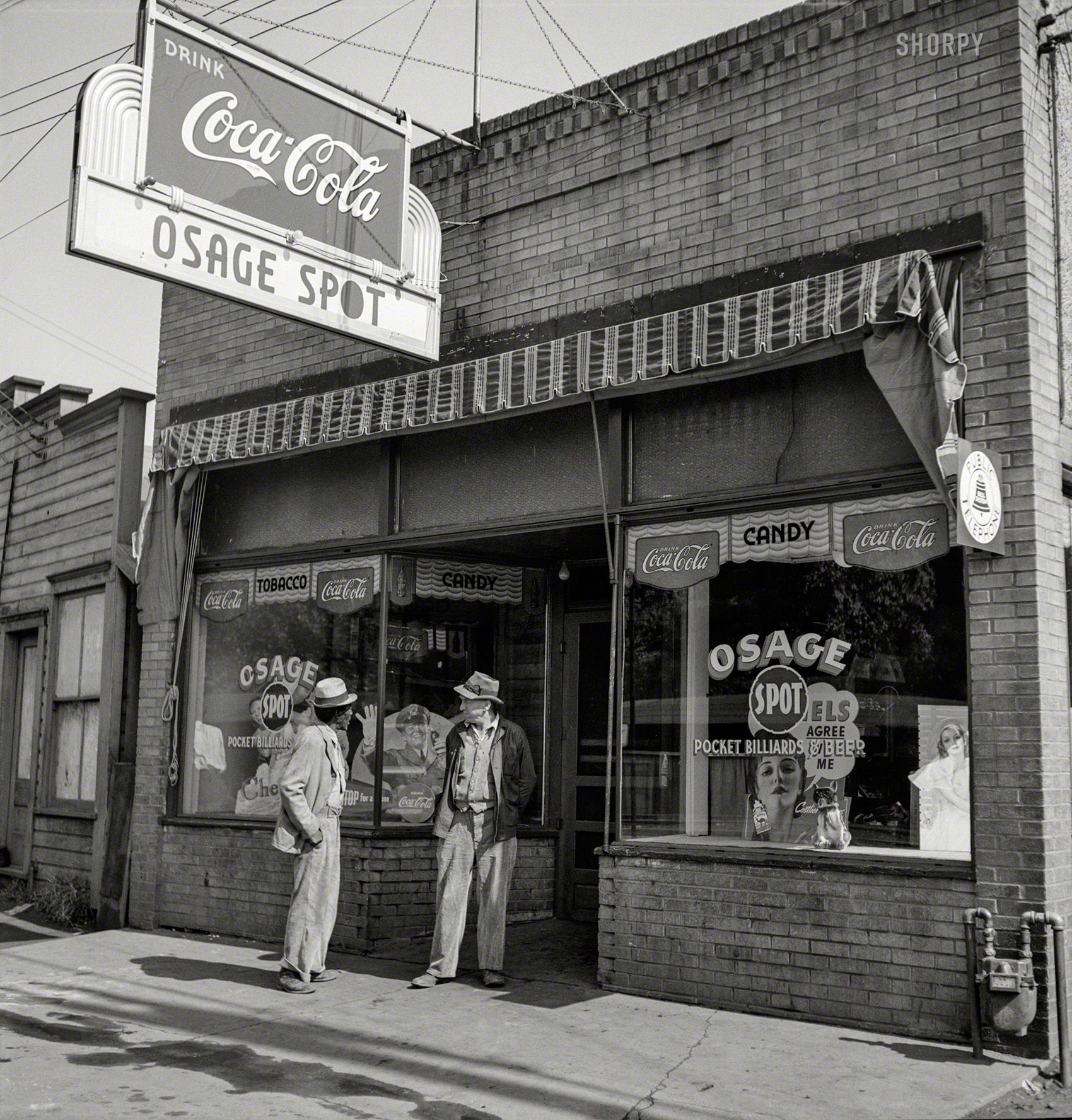 """September 1938. """"Storefront In Mining Town Of Osage, West"""