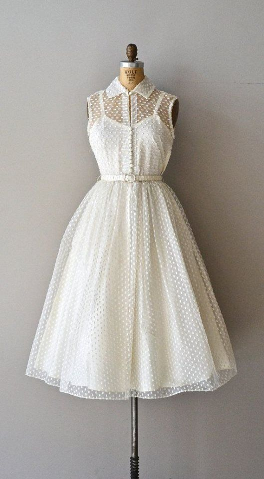 Photo of lovely vintage dress in white dotted swiss