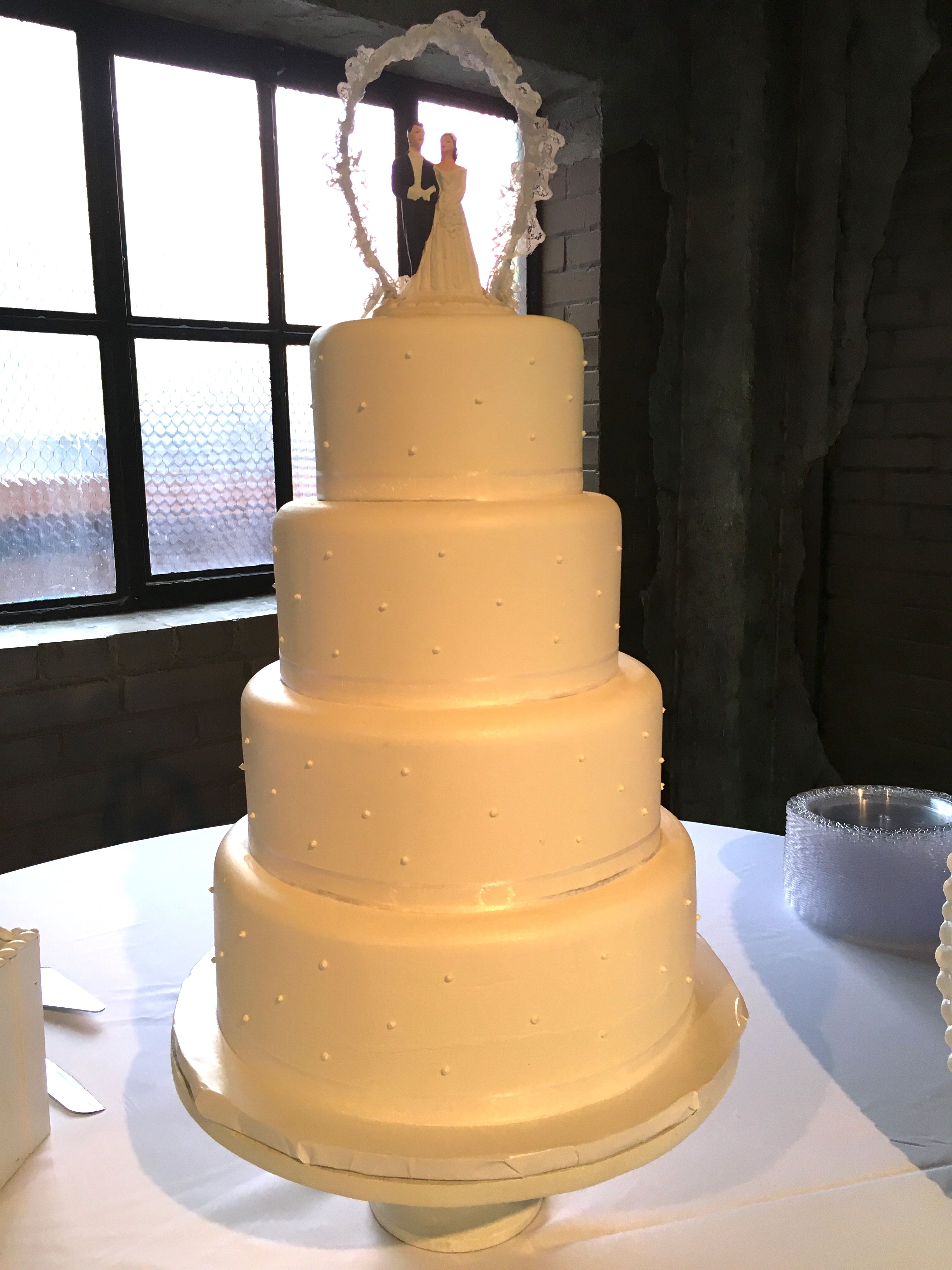 4 tier white wedding cake with dice pattern edible pearls. Matching ...
