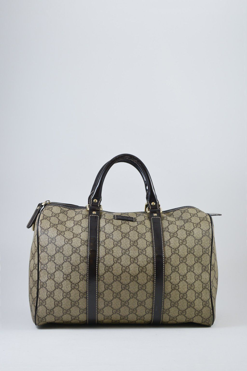 54aff377b Gucci GG Brown Coated Canvas Joy Boston Bag. Twin rolled leather handles  with a fully