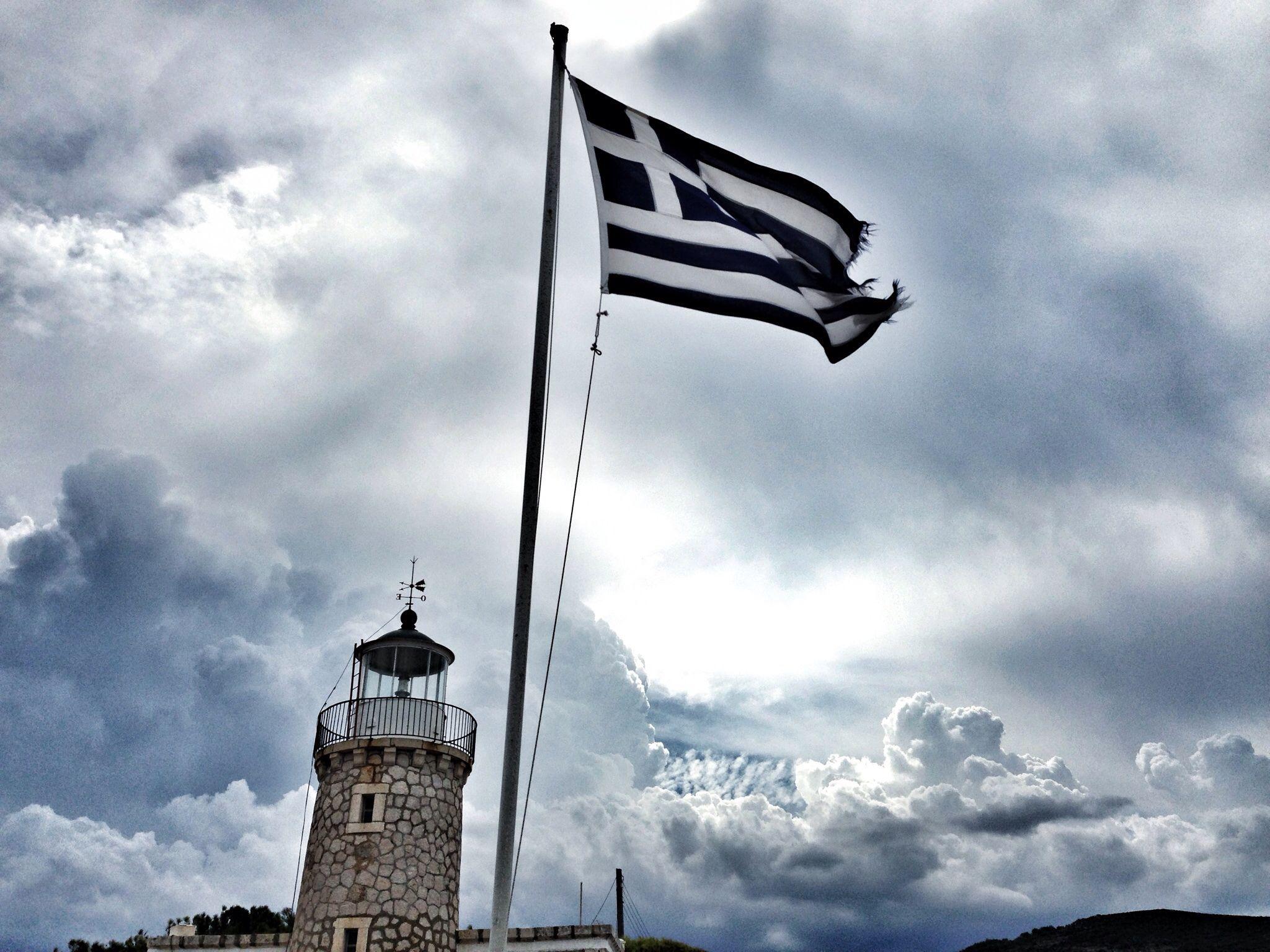 Greek lighthouse with storm clouds