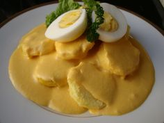 Classic Papa a la Huancaina Revisited // Delicious baked potato swimming in creamy ají chili sauce.
