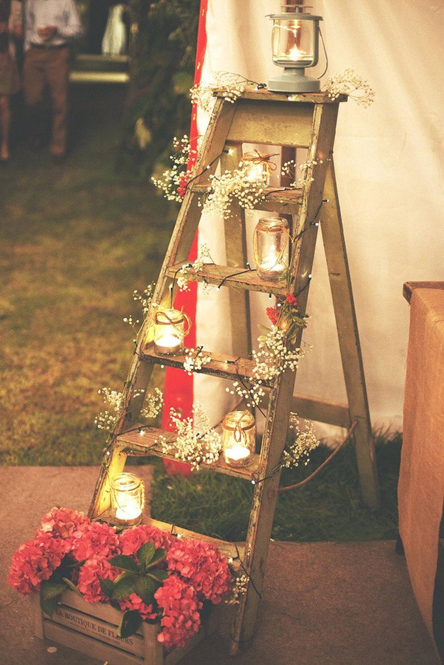Stunning rustic ladder and mason jar flower barn wedding decoration