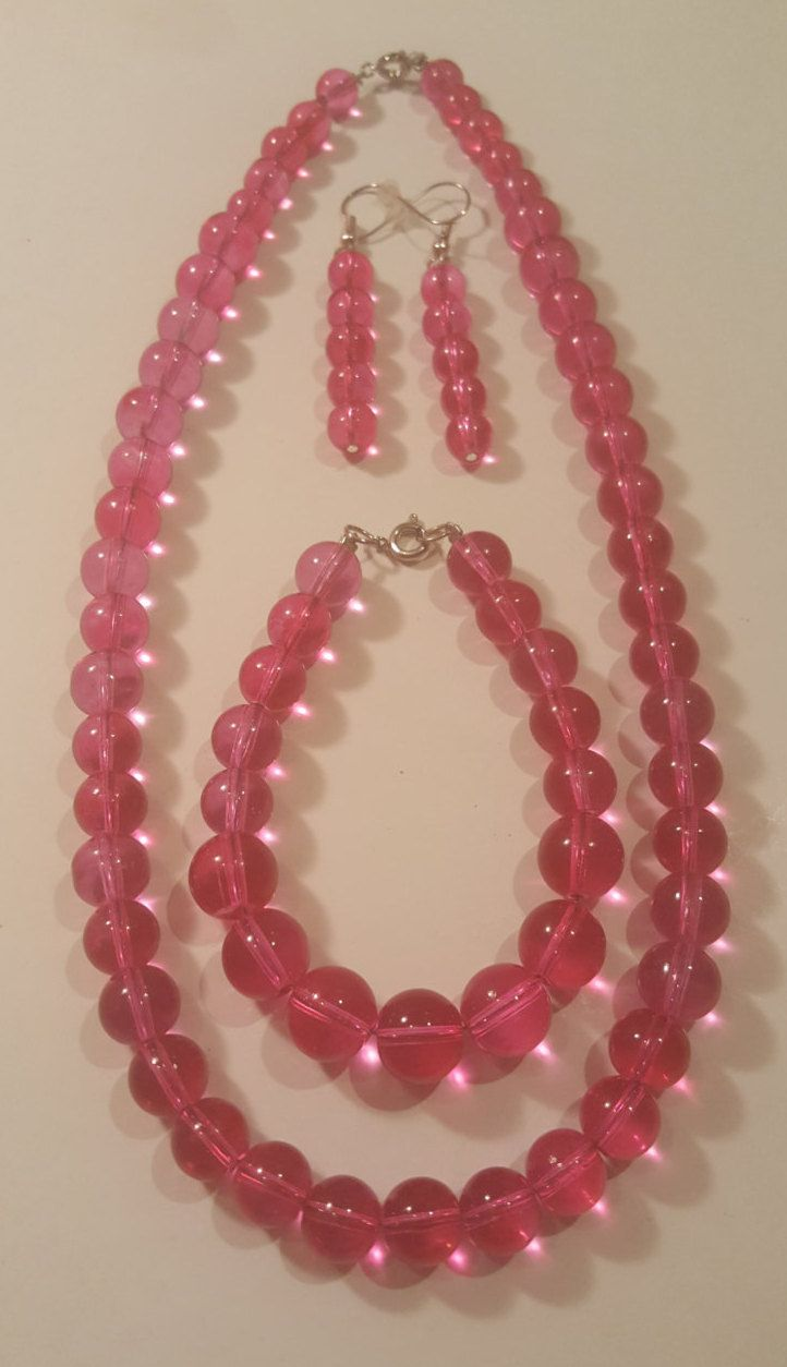 Pink glass beaded jewelry set includes necklace, bracelet, and earrings by craftybb1 on Etsy